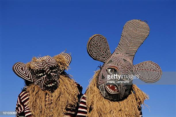 DANCERS WITH TRADITIONAL MASK IN ZIMBABWE