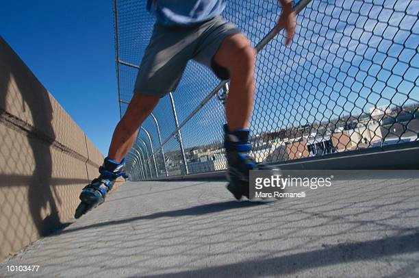 INLINE SKATER ON BRIDGE IN ALBUQUERQUE, NEW MEXICO