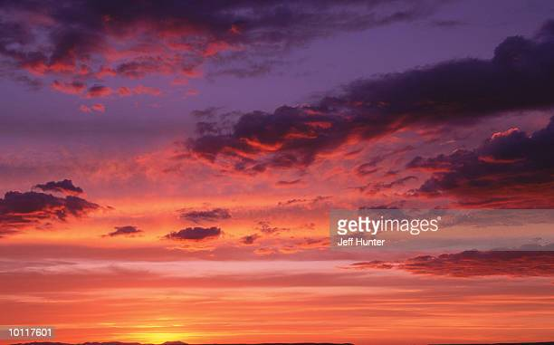 sunset or sunrise in multi colored sunset - {{asset.href}} stock pictures, royalty-free photos & images