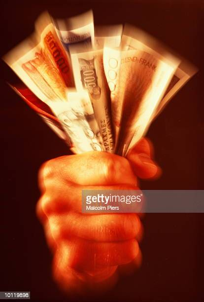 hand holding european notes - los siete pecados capitales fotografías e imágenes de stock