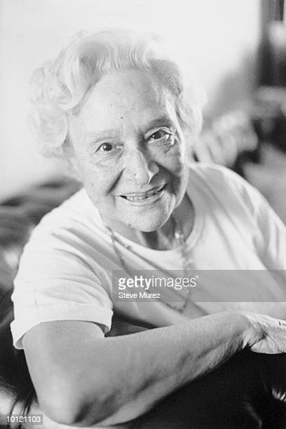 eighty year old woman with arm over couch - 63 year old female stock pictures, royalty-free photos & images