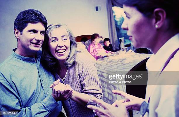 couple receiving good news about parent - cross processed stock pictures, royalty-free photos & images