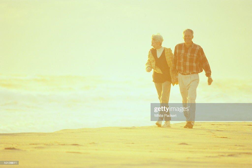 MATURE COUPLE WALKING ON BEACH- NANTUCKET : Stock Photo