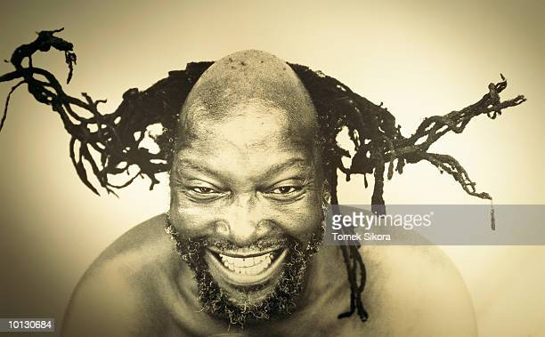 AFRICAN MAN WITH FUNNY HAIR STYLE