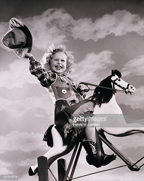 GIRL PLAYS COWGIRL WITH HOBBYHORSE, 1948