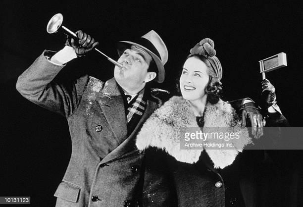 COUPLE CELEBRATING NEW YEARS EVE, 1939
