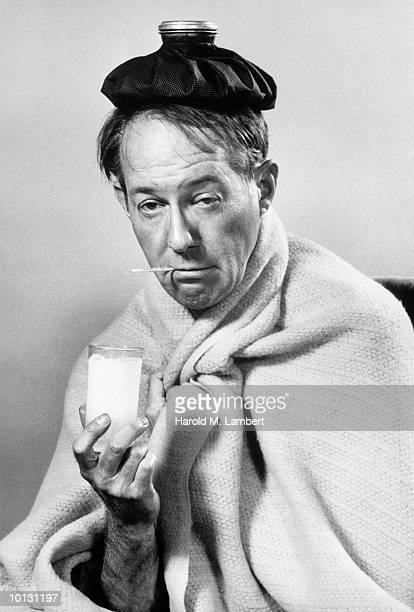 SICK MAN WITH ICE BAG AND MEDICINE, 1969