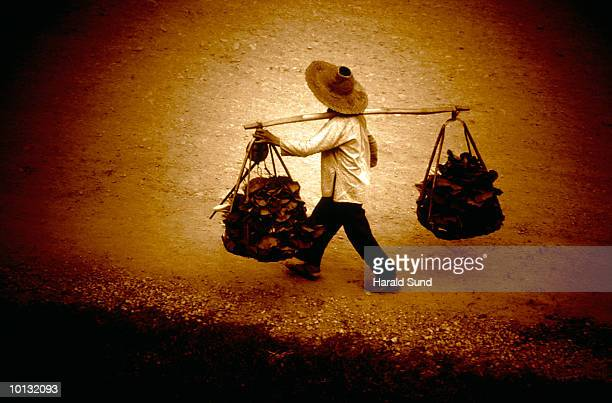 WOMAN CARRYING VEGETABLES WITH BALANCE POLE, CHINA