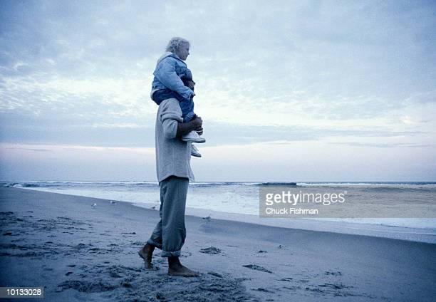 FATHER AND SON ON BEACH SAND DUNE, LONG ISLAND, NEW YORK