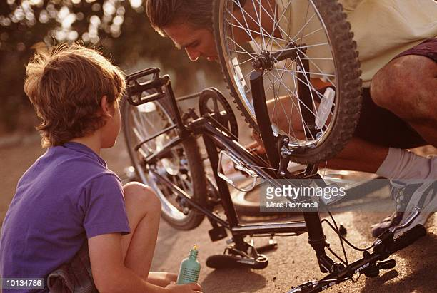 FATHER AND SON FIXING BIKE, SANTA FE, NEW MEXICO