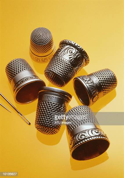 antique thimbles - thimble stock photos and pictures