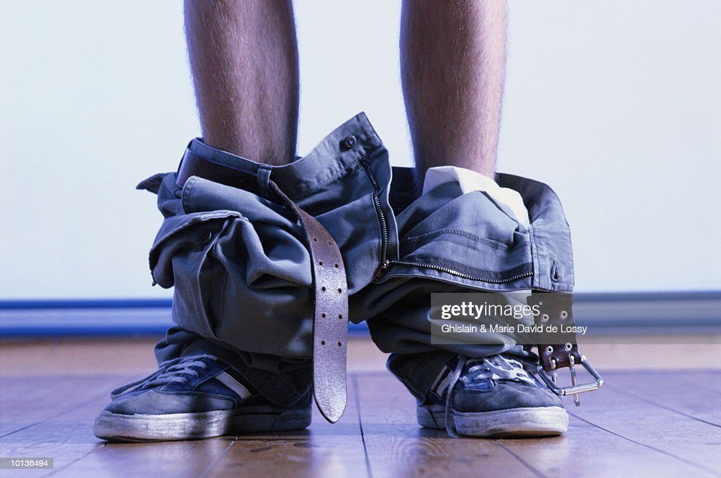 LEGS WITH PANTS AROUND ANKLES : Stock Photo