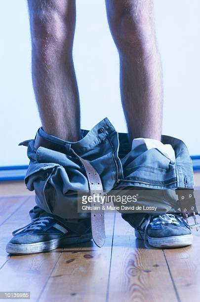 legs with pants around ankles - flasher stock photos and pictures