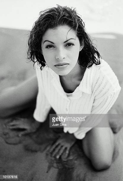 YOUNG LATIN WOMAN AT THE BEACH