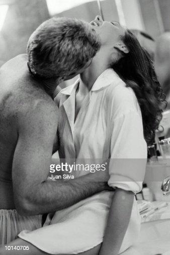 Keywords. Couple Wearing Bathrobes Kissing In Bathroom Stock Photo   Getty