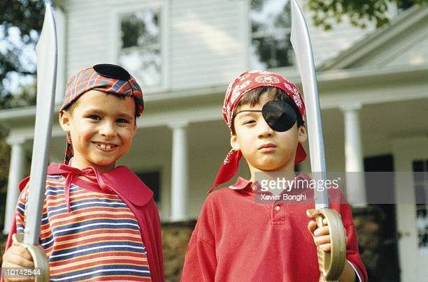 YOUNG BOYS IN PIRATE COSTUMES