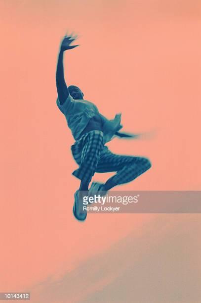 AFRO-CARIBBEAN MAN JUMPING