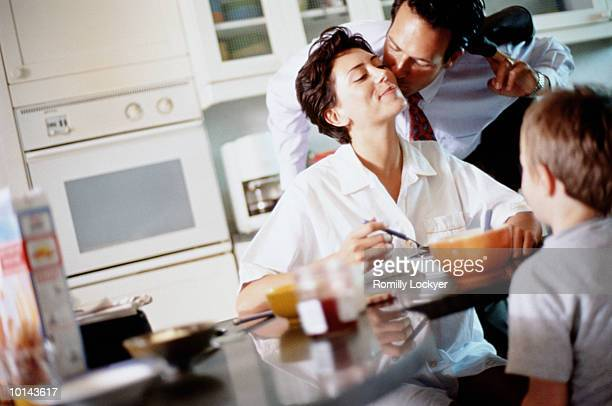 FAMILY BREAKFAST, MOM AND SON EATING, DAD KISSING GOODBYE