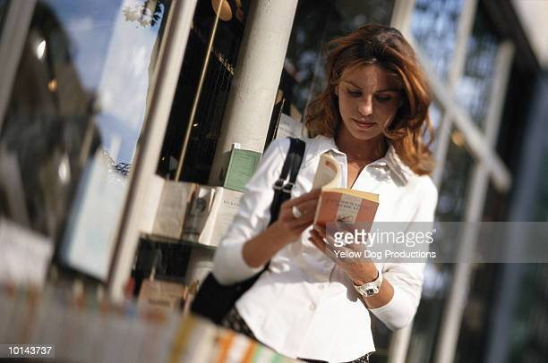 WOMAN BOOK SHOPPING IN PARIS, FRANCE