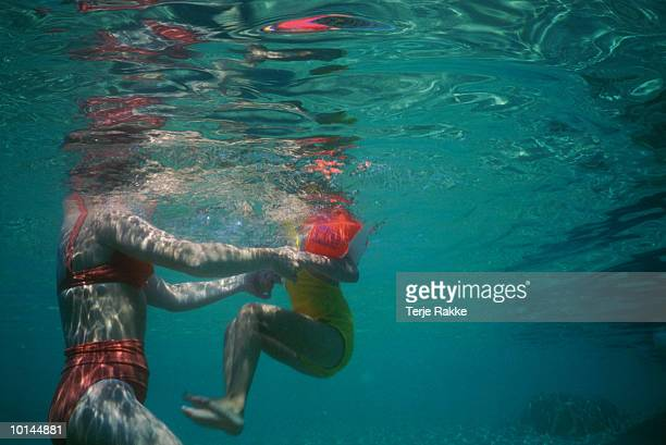 MOTHER AND GIRL BATHING UNDERWATER VIEW