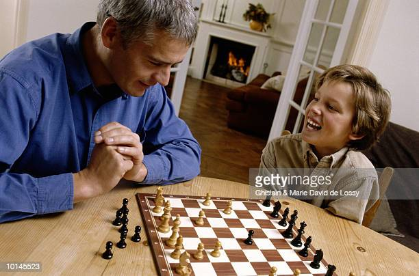 FATHER AND SON PLAYING CHESS