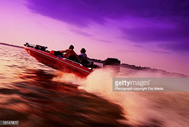 men in speedboat - only men stockfoto's en -beelden