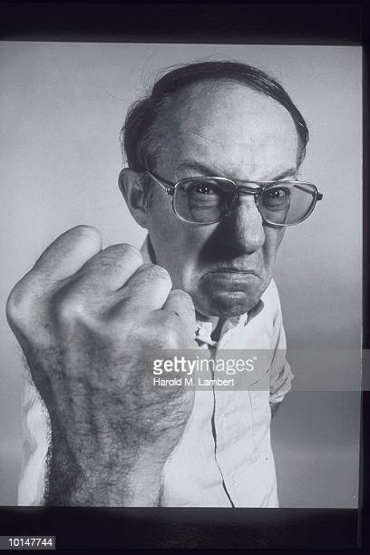 MAN RAISING FIST TO CAMERA, 1972