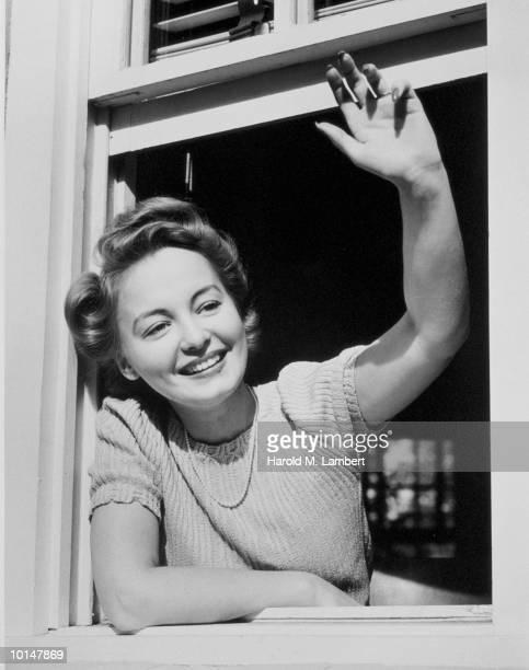 WOMAN WAVING FROM WINDOW, 1949