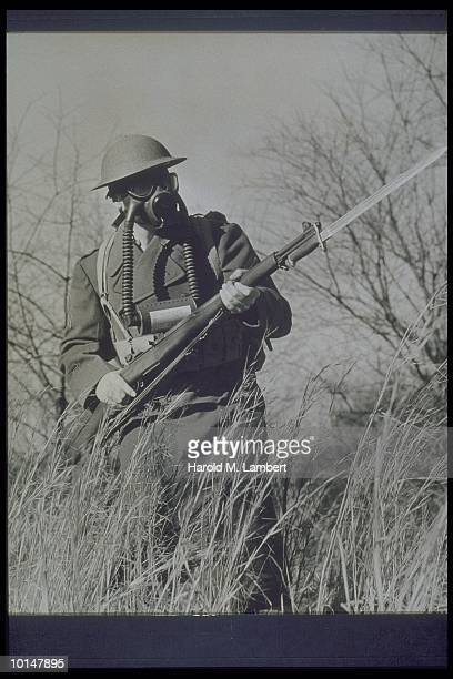 MAN WEARING WORLD WAR IFIGHTING GEAR