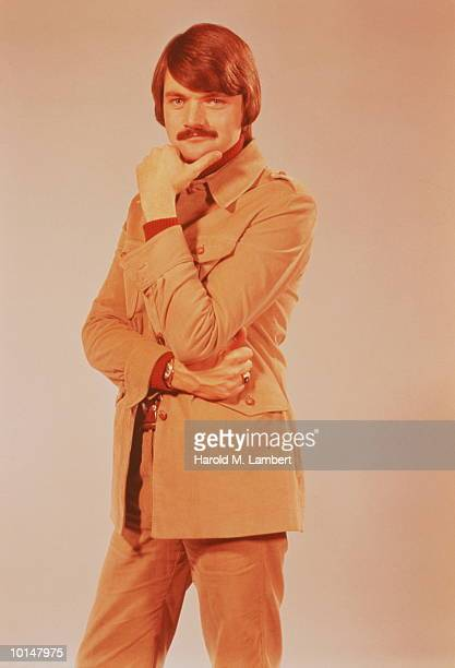 MUSTACHIOED MAN WEARING LEISURE SUIT