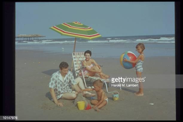 FAMILY ON THE BEACH, 1958