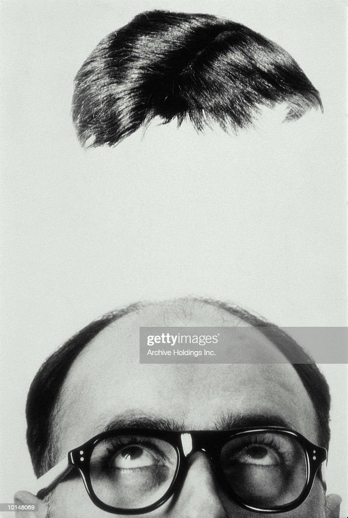 MANS TOUPEE HOVERING OVERHEAD, 1965 : Stock Photo