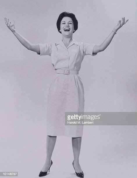 WOMAN SMILING, ARMS OUTSTRETCHED, 1960