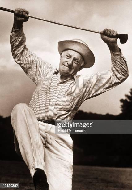 OLDER MAN READYING TO BREAK GOLF CLUB, 1960S