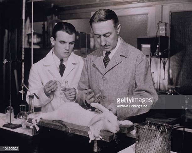 TWO SCIENTISTS IN A LABORATORY IN THE 1930S