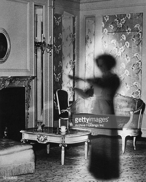 SHADOWY FIGURE OF WOMAN IN SITTING ROOM