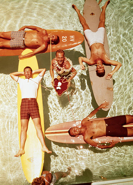 MEN ON SURFBOARDS IN POOL SIPPING DRINKS Wall Art