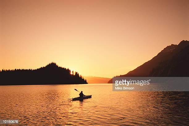 SEA KAYAKER AT SUNSET, GLACIER BAY