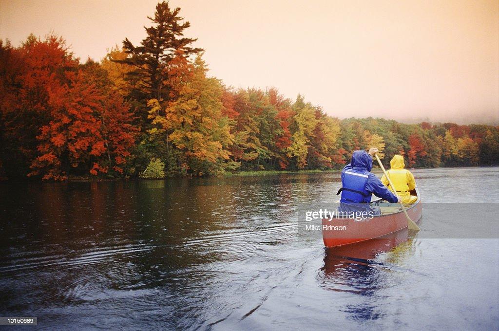 COUPLE CANOEING ON LAKE, CAMDEN, MAINE : Stock Photo