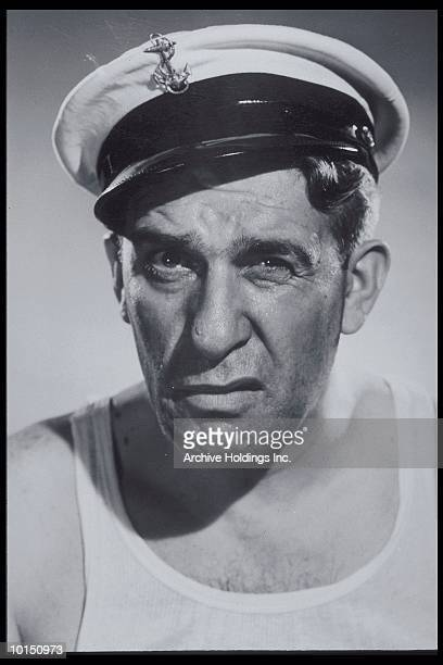 MIDDLE AGED MAN IN SAILORS HAT, 1940S