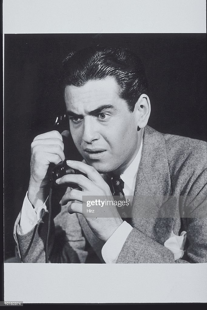 BUSINESSMAN ON THE TELEPHONE, CIRCA 1940S : Stockfoto
