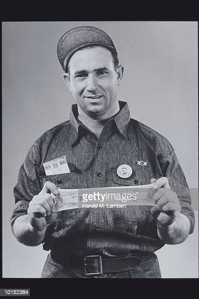 WORKER STRETCHING A FAKE 10 DOLLAR BILL