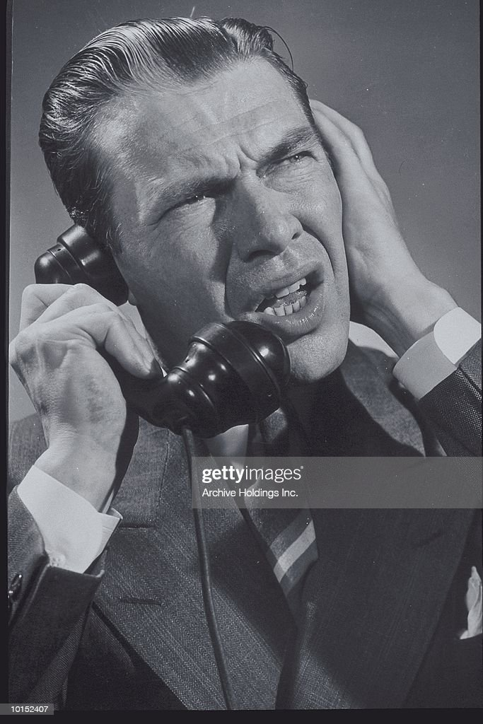 BUSINESSMAN ON THE PHONE, CIRCA 1949 : Stockfoto