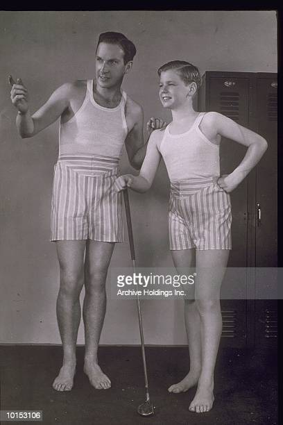 MAN AND BOY WEARING BOXER SHORTS, 1940