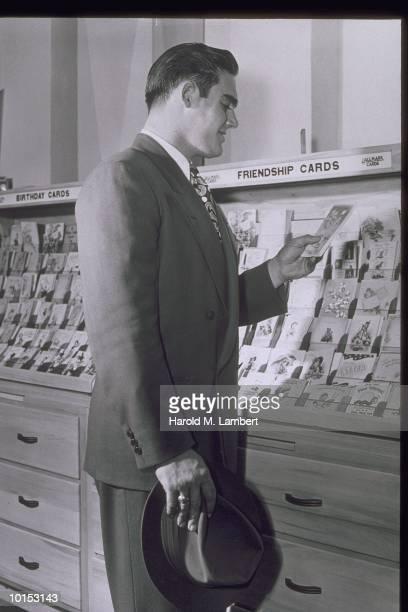 MAN VIEWING HALLMARK CARDS, 1940S