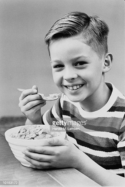BOY EATING BOWL OF CEREAL, 1940S