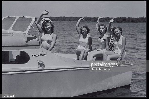 FOUR YOUNG BATHING BEAUTIES IN MOTORBOAT