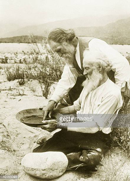 MEN PANNING FOR GOLD IN THE DESERT