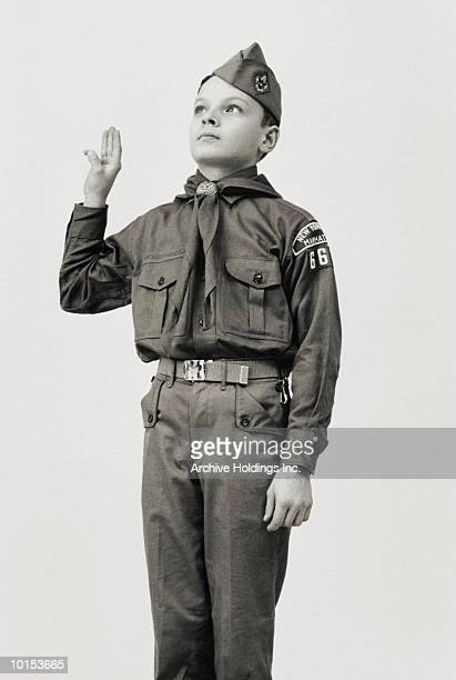 boy scout saluting - boy scout stock photos and pictures