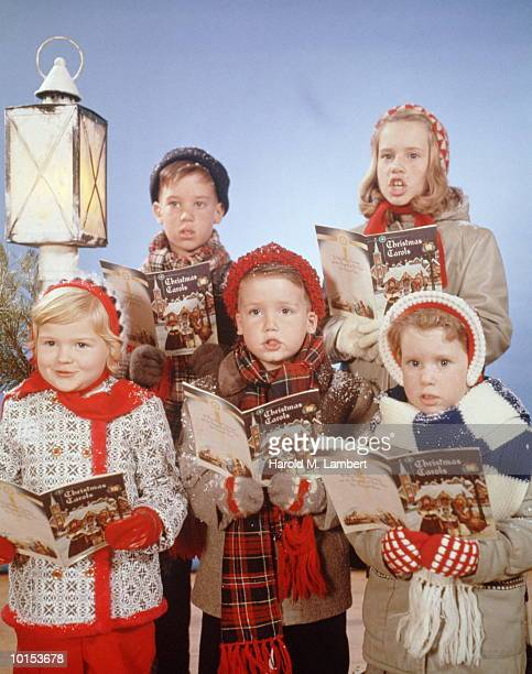 KIDS SING FROM BOOKS OF CHRISTMAS CAROLS